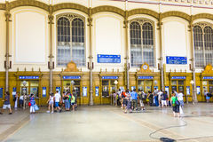 People at the booking terminals inside Budapest's West Train Station Stock Photos