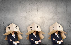 People with boxes on head Stock Photography
