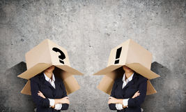 People with boxes on head Royalty Free Stock Photo