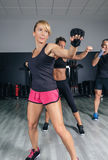 People in a boxing class training punch Stock Images