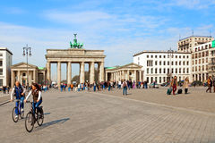 People in Brandenburg Gate, Berlin Stock Photo