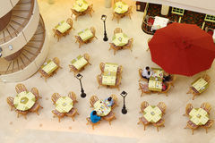 People breakfast in hotel restaurant. Top view; spiral staircase Royalty Free Stock Photo