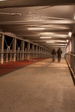People on the bridge. Couple of people on the bridge,night on the town stock photography