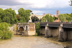 People on the bridge across the Tiber in Rome, Italy Royalty Free Stock Image