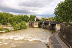 People on the bridge across the Tiber in Rome, Italy Stock Photography