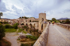 People on the bridge of Besalu Stock Photos