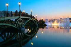 People on bridge and fountain on sunset. Moscow. royalty free stock photography