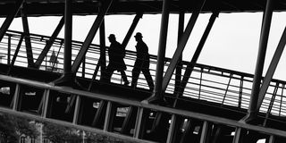 People on bridge Stock Images