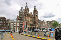 People on the bridge near the Basilica of St. Nicholas. Amsterdam Stock Photos
