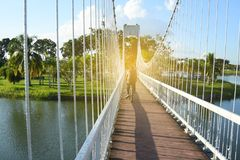 People on the bridge at public park in evening. People on the bridge at public park in evening stock photos
