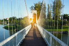 People on the bridge at public park in evening. People on the bridge at public park in evening royalty free stock images