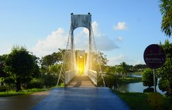 People on the bridge at public park in evening. People on the bridge at public park in evening royalty free stock photo