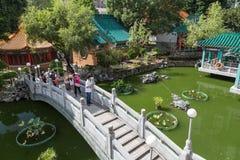 People at a bridge at the Wong Tai Sin Temple Royalty Free Stock Photos