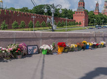 People bring flowers to honor memory of Boris Nemtsov. MOSCOW, RUSSIA - JUNE 4, 2016: Flowers at Bolshoy Moskvoretsky bridge in Moscow. People bring flowers to Stock Images