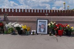 People bring flowers to honor memory of Boris Nemtsov. MOSCOW, RUSSIA - JUNE 4, 2016: Flowers at Bolshoy Moskvoretsky bridge in Moscow. People bring flowers to Stock Photo