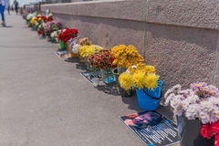People bring flowers to honor memory of Boris Nemtsov. MOSCOW, RUSSIA - JUNE 4, 2016: Flowers at Bolshoy Moskvoretsky bridge in Moscow. People bring flowers to Stock Photos