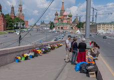 People bring flowers to honor memory of Boris Nemtsov. MOSCOW, RUSSIA - JUNE 4, 2016: Flowers at Bolshoy Moskvoretsky bridge in Moscow. People bring flowers to Stock Photography