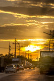 People bring to drive a car. To return to the accommodation duri. Mueang, Songkhla, Thailand ,2015-08-14 : Sunset through the streets in the industrial zone Stock Photos
