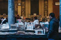 People browse books at second hand book market in the courtyard of the Vieille Bourse old stock exchange in Lille, France. Royalty Free Stock Photo