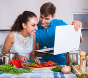People browsing internet for recipe Stock Photo
