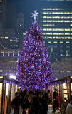 People in Bryant Park with Christmas Tree in background Royalty Free Stock Image