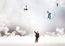 People and bubbles. Business people in 3d bubbles Stock Photos