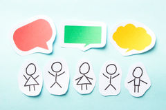 People with bubbles. Paper people with colorful blank dialog speech bubbles Royalty Free Stock Photos