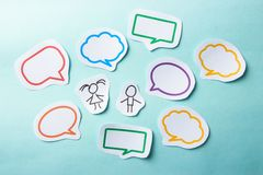 People with bubbles social networking. Paper people with colorful blank dialog speech bubbles. Social networking concept Royalty Free Stock Photos