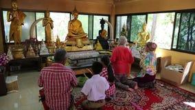 People in Buddhist temple on Pratumnak Hill near Golden Buddha statue in Pattaya stock video footage