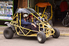 People and Buggy in Banos, Ecuador Stock Images