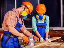People in builder helmet Stock Photos