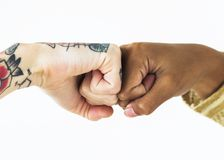People bumping their fists together Stock Images