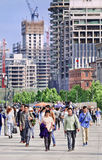 People on Bund boulevard with construction site on background, Shanghai, China. SHANGHAI-MAY 5, 2014. Construction sites near Bund. Because millions of Chinese Stock Photo