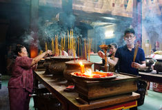 People burn incense at ancient temple Stock Photo