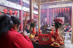 People burn incense pray in temple Stock Images