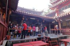People burn incense pray in tzu chi temple Stock Image