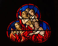 People burning in hell. Stained glass window of burning people in hell Stock Images