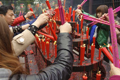 People burning incense upon the incense altar Stock Image