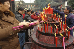 People burning incense upon the incense altar Royalty Free Stock Photos