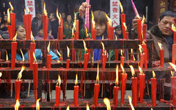 People burning incense upon the incense altar Stock Photo