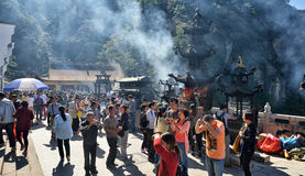 People burning incense and praying Royalty Free Stock Images