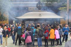 People are burning incense, a religious ritual in the Confucian Lingyin temple, Hangzhou, China Royalty Free Stock Images
