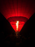 People burning inside red hot air balloon Stock Photo