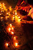 People burning oil lamps as religious ritual in Hindu temple Stock Photography