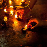 People burning oil lampsl in Hindu temple Royalty Free Stock Photography