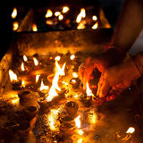 People burning oil lampsl in Hindu temple Stock Photos