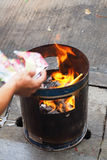 People burns fake money for ancestor beliefs of the Chinese. Chinese burning the offering in traditional cremation stock photography