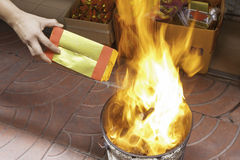 People burns joss paper for ancestor. In chinese new year Stock Photo