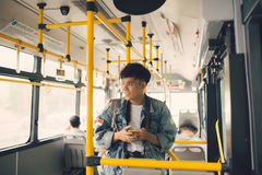 People in the bus. Asian man using smartphone in public transpor Stock Photo