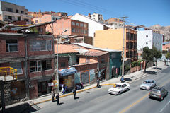 People at the bus station and cars in La Paz city, Bolivia Stock Images